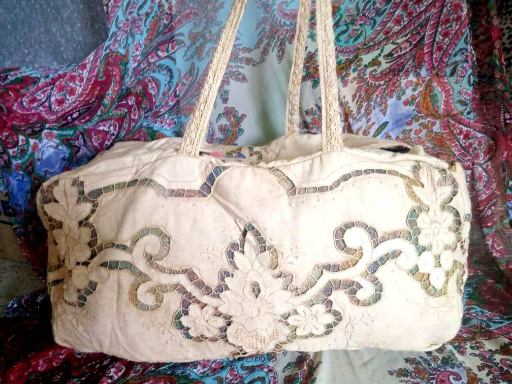cream lace duffle bag